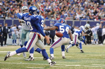 EAST RUTHERFORD, NJ - NOVEMBER 02:  Jeff Feagles #18 of the New York Giants punts against the Dallas Cowboys during their game on November 2, 2008 at Giants Stadium in East Rutherford, New Jersey.  (Photo by Al Bello/Getty Images)