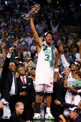 BOSTON - JUNE 17:  Paul Pierce #34 of the Boston Celtics celebrates with the Finals MVP trophy at the end of Game Six of the 2008 NBA Finals against the Los Angeles Lakers on June 17, 2008 at TD Banknorth Garden in Boston, Massachusetts. The Celtics defea