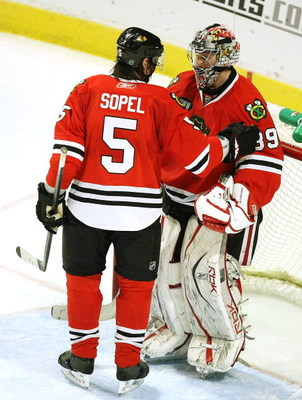 CHICAGO - MARCH 19: Brent Sopel #5 of the Chicago Blackhawks congratulates teammate Nikolai Khabibulin #39 after Khabibulin shut out the Washington Capitals on March 19, 2008 at the United Center in Chicago, Illinois. (Photo by Jonathan Daniel/Getty Image