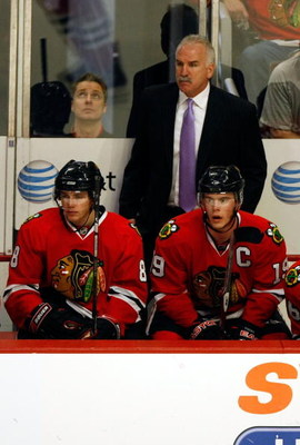 CHICAGO - MAY 24:  Head coach Joel Quenneville of the Chicago Blackhawks stands on the bench behind Patrick Kane #88 and Jonathan Toews #19 against the Detroit Red Wings during Game Four of the Western Conference Championship Round of the 2009 Stanley Cup