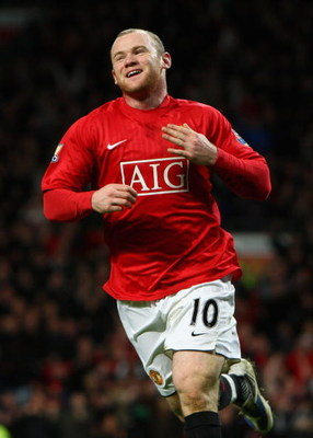 MANCHESTER, UNITED KINGDOM - FEBRUARY 21:  Wayne Rooney of Manchester United celebrates scoring the opening goal during the Barclays Premier League match between Manchester United and Blackburn Rovers at Old Trafford on February 21, 2009 in Manchester, En