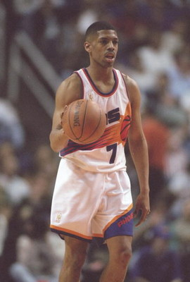 14 Feb 1997: Guard Kevin Johnson of the Phoenix Suns dribbles the ball down the court during a game against the Los Angeles Clippers at the America West Arena in Phoenix, Arizona. The Suns won the game 110-93.