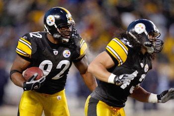 PITTSBURGH - DECEMBER 7:  James Harrison #92 of the Pittsburgh Steelers runs with the ball after a fumble recovery during their NFL game against the Dallas Cowboys on December 7, 2008 at Heinz Field in Pittsburgh, Pennsylvania. The Steelers defeated the C