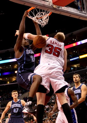 LOS ANGELES, CA - NOVEMBER 03:  Paul Millsap #24 of the Utah Jazz dunks over Chris Kaman #35 of the Los Angeles Clippers on November 3, 2008 at Staples Center in Los Angeles, California. The Jazz won 89-73.  NOTE TO USER: User expressly acknowledges and a