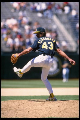 20 Jun 1995:  Pitcher Dennis Eckersley of the Oakland Athletics winds up to pitch against the Minnesota Twins at Oakland Alameda Stadium in Oakland, California.  The A's defeated the Twins 5-2.  Mandatory Credit:  Otto Greule/Allsport
