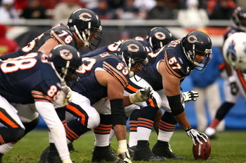 CHICAGO - NOVEMBER 09:  Olin Kreutz #57 of the Chicago Bears centers the ball at the line of scrimmage against the Tennessee Titans at Soldier Field on November 9, 2008 in Chicago, Illinois. The Titans won 21-14. (Photo by Jonathan Ferrey/Getty Images)