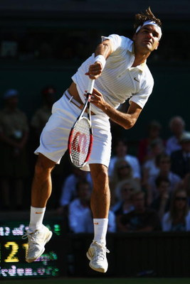 WIMBLEDON, ENGLAND - JULY 05:  Roger Federer of Switzerland serves during the men's singles final match against Andy Roddick of USA on Day Thirteen of the Wimbledon Lawn Tennis Championships at the All England Lawn Tennis and Croquet Club on July 5, 2009