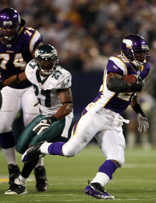 MINNEAPOLIS - JANUARY 4:   Adrian Peterson #28 of the Minnesota Vikings runs past Quentin Mikell #27 of the Philadelphia Eagles during the NFC Wild Card playoff game on January 4,2009 at the Hubert H. Humphrey Metrodome in Minneapolis, Minnesota. (Photo b