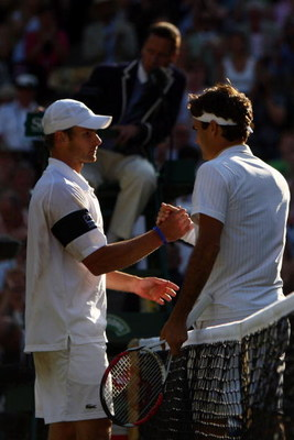 WIMBLEDON, ENGLAND - JULY 05:  Roger Federer of Switzerland shakes hands with Andy Roddick of USA after the men's singles final match on Day Thirteen of the Wimbledon Lawn Tennis Championships at the All England Lawn Tennis and Croquet Club on July 5, 200