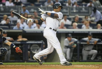NEW YORK - JULY 2: Robinson Cano #24 of the New York Yankees bats against the Seattle Mariners at Yankee Stadium on July 2, 2009 in the Bronx borough of New York City.  (Photo by Nick Laham/Getty Images)
