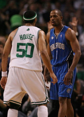 BOSTON - MAY 06:  Rafer Alston #1 of the Orlando Magic and Eddie House #50 of the Boston Celtics exchange words after House scored a three-point shot in the second half in Game Two of the Eastern Conference Semifinals during the 2009 NBA Playoffs at TD Ba
