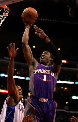 LOS ANGELES, CA - JANUARY 11: Amare Stoudemire #1 of the Phoenix Suns shoots over Brian Skinner #8 of the Los Angeles Clippers on January 11, 2009 at Staples Center in Los Angeles, California.  NOTE TO USER: User expressly acknowledges and agrees that, by