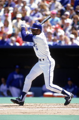 KANSAS CITY, MO - 1990:  Willie Wilson #6 of the Kansas City Royals swings the bat during a game in the 1990 season at Royals Stadium in Kansas City, Missouri.  (Photo by Jonathan Daniel/Getty Images)