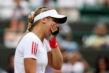 WIMBLEDON, ENGLAND - JUNE 27:  Sabine Lisicki of Germany shows her emotions as she is victorious during the women's singles third round match against  Svetlana Kuznetsova of Russia on Day Six of the Wimbledon Lawn Tennis Championships at the All England L