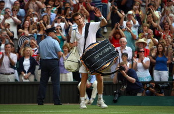 WIMBLEDON, ENGLAND - JULY 03:  Andy Murray of Great Britain waves to the crowd after defeat during the men's singles semi final match against Andy Roddick of USA on Day Eleven of the Wimbledon Lawn Tennis Championships at the All England Lawn Tennis and C