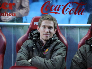 MADRID, SPAIN - MARCH 01: Aleksander Hleb of Barcelona smiles from the subs bench before the La Liga match between Atletico Madrid and Barcelona at the Vicente Calderon stadium on March 1, 2009 in Madrid, Spain.  (Photo by Denis Doyle/Getty Images)