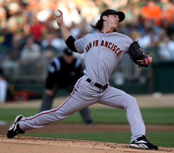 OAKLAND, CA - JUNE 23:  Tim Lincecum #55 of the San Francisco Giants pitches against the Oakland Athletics during a Major League Baseball game on June 23, 2009 at the Oakland Coliseum in Oakland, California.  (Photo by Jed Jacobsohn/Getty Images)