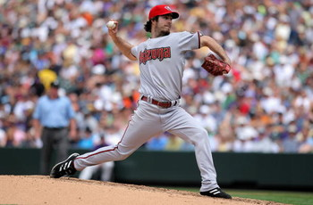 DENVER - JULY 05:  Starting pitcher Dan Haren #15 of the Arizona Diamondbacks delivers against the Colorado Rockies during MLB action at Coors Field on July 5, 2009 in Denver, Colorado. Haren earned the win as the Diamondbacks defeated the Rockies 4-3.  (