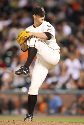 SAN FRANCISCO - AUGUST 28:   Pitcher Matt Cain #18 of the San Francisco Giants pitches during the game against the Colorado Rockies during a Major League Baseball game on August 28, 2007 at AT&T Park in San Francisco, California.   (Photo by Lisa Blumenfe