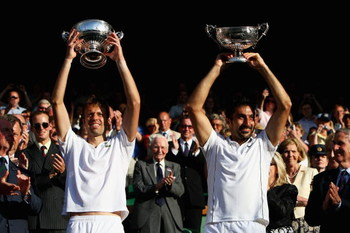 WIMBLEDON, ENGLAND - JULY 04:  Daniel Nestor of Canada (L) and Nenad Zimonjic of Serbia celebrate victory with their trophies after the men's doubles final match against Bob Bryan of USA and Mike Bryan of USA on Day Twelve of the Wimbledon Lawn Tennis Cha