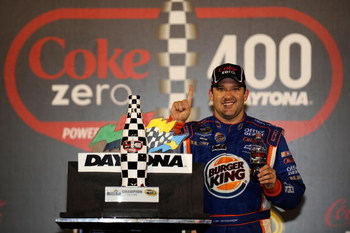 DAYTONA BEACH, FL - JULY 04: Tony Stewart, driver of the #14 Burger King Chevrolet, celebrates in victory lane after winning the NASCAR Sprint Cup Series 51st Annual Coke Zero 400 at Daytona International Speedway on July 4, 2009 in Daytona Beach, Florida