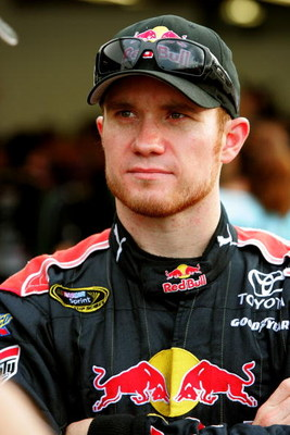 DAYTONA BEACH, FL - JULY 02: Brian Vickers, driver of the #83 Red Bull Toyota, stands in the garage during practice for the NASCAR Sprint Cup Series Coke Zero 400 at Daytona International Speedway on July 2, 2009 in Daytona Beach, Florida.  (Photo by Jerr