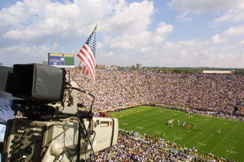 22 Sep 2001:  A flag is hung from a TV camera to remember the victims of the recent attacks as the University of Michigan Wolverines play against the Western Michigan Broncos at Michigan Stadium (The Big House) in Ann Arbor, Michigan.  Michigan beat Weste