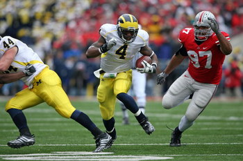 COLUMBUS, OH - NOVEMBER 22:  Brandon Minor #4 of the Michigan Wolverines runs with the ball during the Big Ten Conference game against the Ohio State Buckeyes at Ohio Stadium on November 22, 2008 in Columbus, Ohio.  (Photo by Andy Lyons/Getty Images)