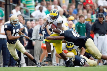 SOUTH BEND,IN - SEPTEMBER 13:  Brandon Minor #4 of the Michigan Wolverines carries the ball during the game against the Notre Dame Fighting Irish on September 13, 2008 at Notre Dame Stadium in South Bend, Indiana. (Photo by: Gregory Shamus/Getty Images)