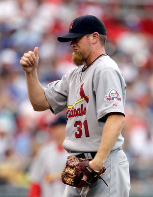 KANSAS CITY, MO - JUNE 20:  Pitcher Ryan Franklin #31 of the St. Louis Cardinals gives a thumbs up to catcher Yadier Molina #4 during the game against the Kansas City Royals on June 20, 2009 at Kauffman Stadium in Kansas City, Missouri.  (Photo by Jamie S