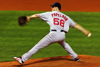 CLEVELAND - OCTOBER 18:  Closing pitcherJonathan Papelbon #58 of the Boston Red Sox delivers against the Cleveland Indians during Game Five of the American League Championship Series at Jacobs Field on October 18, 2007 in Cleveland, Ohio.  The Red Sox won