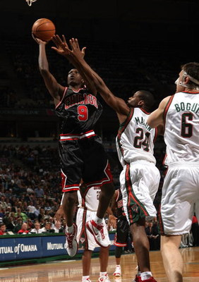 MILWAUKEE - APRIL 14: Loul Deng #9 of the Chicago Bulls puts up a shot against Desmond Mason #24 and Andrew Bogut #6 of the Milwaukee Bucks on April 14, 2008 at the Bradley Center in Milwaukee, Wisconsin. NOTE TO USER: User expressly acknowledges and agre