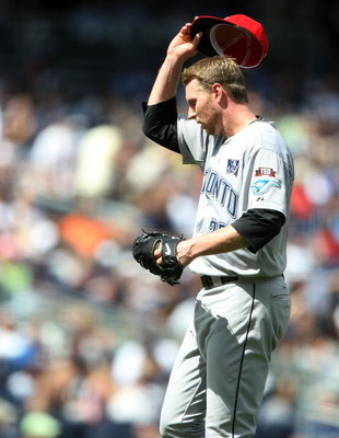 NEW YORK - JULY 04:  Roy Halladay #32 of the Toronto Blue Jays removes his hat against the New York Yankees on July 4, 2009 at Yankee Stadium in the Bronx borough of New York City.  (Photo by Nick Laham/Getty Images)
