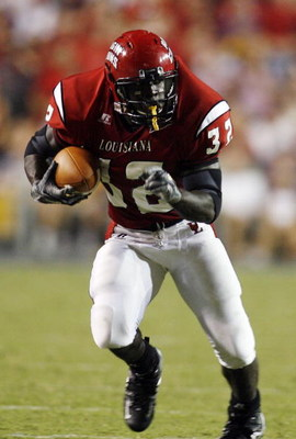 BATON ROUGE, LA - SEPTEMBER 02:  Tyrell Fenroy #32 of the University of Louisiana Lafayette runs against  Louisiana State University on September 2, 2006 at Tiger Stadium in Baton Rouge, Louisiana.  LSU defeated ULL 45-3.   (Photo by Chris Graythen/Getty 
