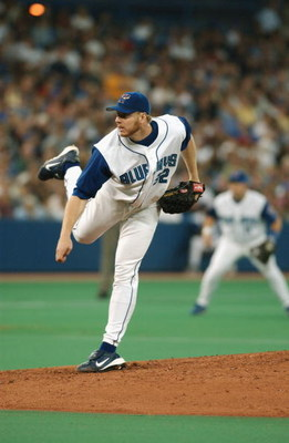 TORONTO - JULY 12:  Pitcher Roy Halladay #32 of the Toronto Blue Jays delivers a pitch during the American League game against the New York Yankees at SkyDome on July 12, 2003 in Toronto, Ontario. The Blue Jays won the game 10-3.  (Photo By Dave Sandford/