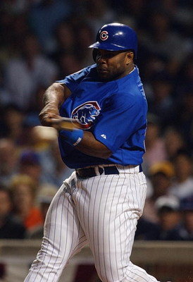 CHICAGO - OCTOBER 7:  First baseman Randall Simon #35 of the Chicago Cubs swings during game one of the National League Championship Series against the Florida Marlins on October 7, 2003 at Wrigley Field in Chicago, Illinois. The Marlins won 9-8. (Photo b