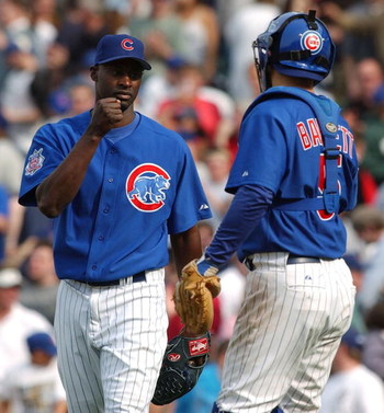 CHICAGO - APRIL 15: Relief pitcher LaTroy Hawkins #32 of the Chicago Cubs is congratulated by catcher Michael Barrett #5 after finishing the game against the Pittsburgh Pirates on April 15, 2004 at Wrigley Field in Chicago, Illinois. The Cubs defeated the