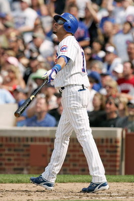 CHICAGO - JUNE 20:  Aramis Ramirez #16 of the Chicago Cubs follows his home run hit during the game against the Chicago White Sox on June 20, 2008 at Wrigley Field in Chicago, Illinois. The Cubs defeated the White Sox 4-3. (Photo by Jonathan Daniel/Getty