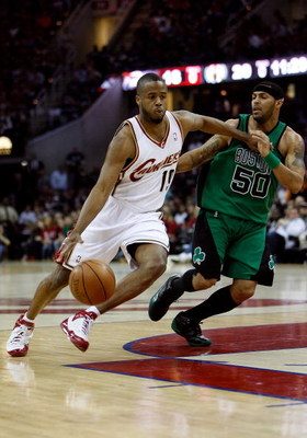 CLEVELAND - MAY 16:  Damon Jones #19 of the Cleveland Cavaliers drives against Eddie House #50 of the Boston Celtics in Game Six of the Eastern Conference Semifinals during the 2008 NBA Playoffs on May 16, 2008 at the Quicken Loans Arena in Cleveland, Ohi