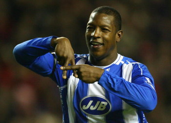 LIVERPOOL, UNITED KINGDOM - JANUARY 02:  Titus Bramble of Wigan Athletic celebrates scoring an equalising goal during the Barclays Premier League match between Liverpool and Wigan Athletic at Anfield on January 02, 2008 in Liverpool, England.  (Photo by A