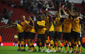 LIVERPOOL, ENGLAND - MAY 26:  The Arsenal team celebrate winning the FA Youth Cup during the second leg of the FA Youth Cup final sponsored by E.ON, between Liverpool and Arsenal at Anfield on May 26, 2009 in Liverpool, England.  (Photo by Jamie McDonald/