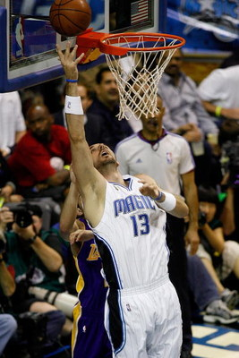 ORLANDO, FL - JUNE 14:  Marcin Gortat #13 of the Orlando Magic puts a shot up in Game Five of the 2009 NBA Finals against the Los Angeles Lakers on June 14, 2009 at Amway Arena in Orlando, Florida.  The Lakers won 99-86.  NOTE TO USER:  User expressly ack
