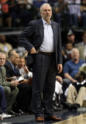 DALLAS - APRIL 25:  Head coach Gregg Popovich of the San Antonio Spurs during play against the Dallas Mavericks in Game Four of the Western Conference Quarterfinals during the 2009 NBA Playoffs at American Airlines Center on April 25, 2009 in Dallas, Texa