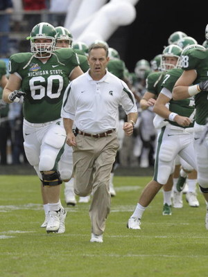 ORLANDO, FL - JANUARY 1: Coach Mark Dantonio of the Michigan State Spartans leads the team to the field for play against the Georgia Bulldogs at the 2009 Capital One Bowl at the Citrus Bowl on January 1, 2009 in Orlando, Florida.  (Photo by Al Messerschmi