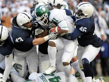 STATE COLLEGE, PA - NOVEMBER 22:  Glenn Winston #41 of the Michigan State Spartans is stopped for a loss by Josh Hull #43 and Tyrell Sales #46 of the Penn State Nittany Lions on November 22, 2008 at Beaver Stadium in State College, Pennsylvania.  (Photo b