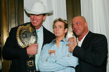 NEW YORK - MARCH 6:  Singer Aaron Carter (C) poses with WWE wrestlers John Bradshaw Layfield (L) and Kurt Angle (R) at the 6th Annual T.J. Martell 'Family' Day' Indoor Carnival Benefit at Cipriani's Fifth Avenue March 6, 2005 in New York City. (Photo by E