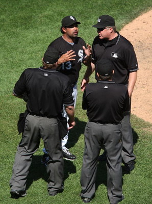 CHICAGO - JUNE 28: Manager Ozzie Guillen #13 of the Chicago White Sox argues with umpires (L-R) Brain Runge #71, Derryl Cousins #13 and Bill Miller #26 during a game against the Chicago Cubs on June 28, 2009 at U.S. Cellular Field in Chicago, Illinois. (P