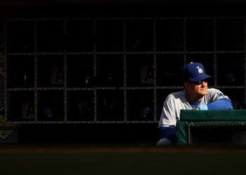 ANAHEIM, CA - JUNE 21:  Manager Joe Torre of the Los Angeles Dodgers  looks on from the dugout during the game with the Los Angeles Angels of Anaheim on June 21, 2009 at Angel Stadium in Anaheim, California.   The Dodgers won 5-3.  (Photo by Stephen Dunn/