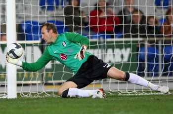 GOLD COAST, AUSTRALIA - JULY 08:  Mark Schwarzer of Fulham saves a goal  during the exhibition football match between Gold Coast United and Fulham FC at Skilled Stadium on July 8, 2009 at the Gold Coast, Australia.  (Photo by Bradley Kanaris/Getty Images)