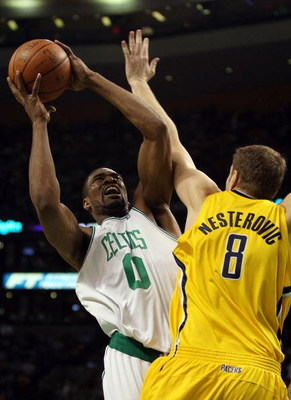 BOSTON - FEBRUARY 27:  Leon Powe #0 of the Boston Celtics takes a shot as Rasho Nesterovic #8 of the Indiana Pacers defends on February 27, 2009 at TD Banknorth Garden in Boston, Massachusetts. NOTE TO USER: User expressly acknowledges and agrees that, by